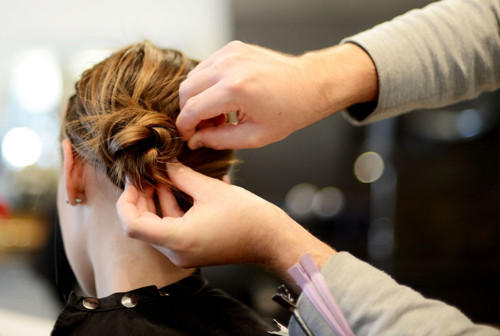 Sophomore Loralee Onstad models a double feather braid tucked into a hair-wrapped ponytail, a simple hair style to accompany fall fashion.