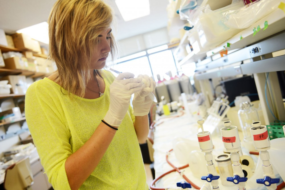 Junior marine biology minor Erika Senyk demonstrates how to filter water samples at the Ecology Building in St. Paul on Friday afternoon. The University started offering a marine biology minor because of strong student interest.