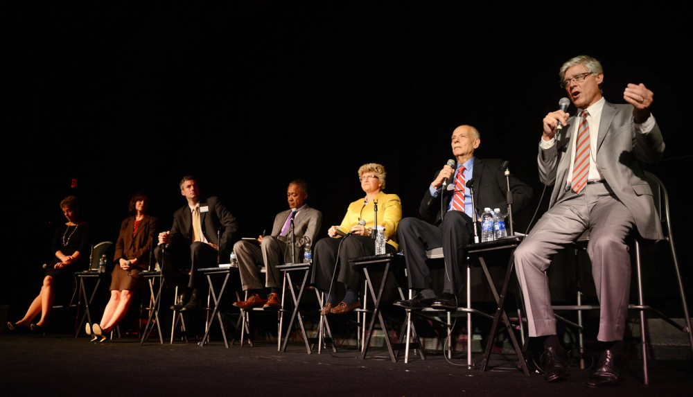 Seven mayor candidates answer questions on stage on Thursday at Parkway Theater in Minneapolis.