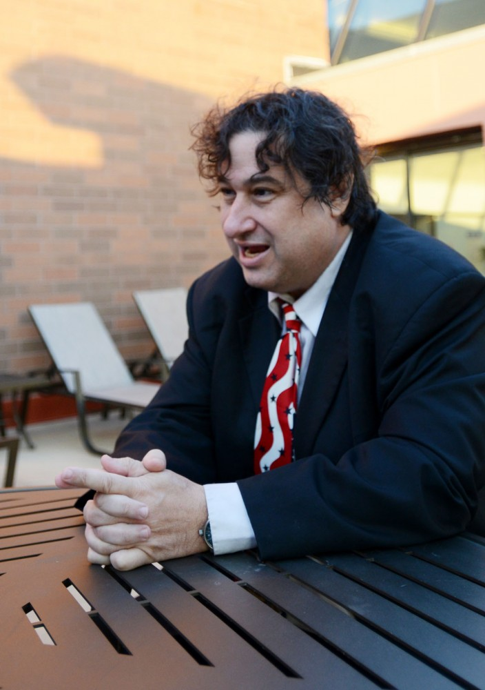 Ward 3 Libertarian Party candidate Michael Katch discusses ideas on Tuesday at his apartment complex in Minneapolis.