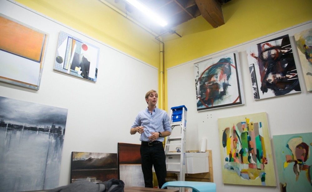 Ruckus founder Jon Piepho gestures to the artwork he's  selling for his art shop project on Monday, Sept. 16, 2013 in Northeast Minneapolis.
