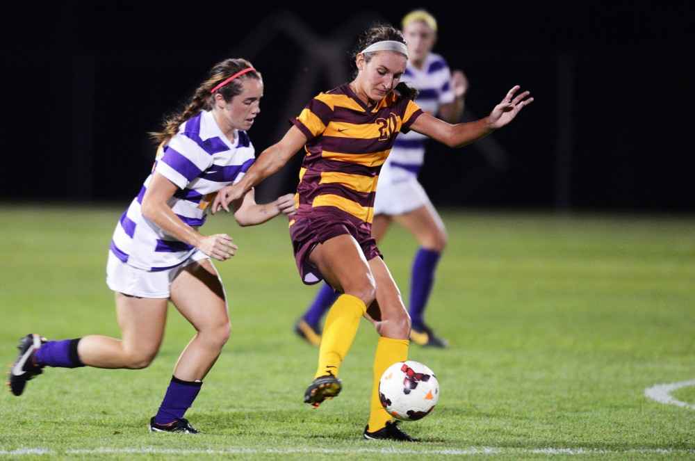Minnesota defender Becca Roberts steals the ball from Louisiana State on Friday, Sept. 6, 2013. Gophers won 2-1 against the LSU Tigers at Elizabeth Lyle Robbie Stadium.