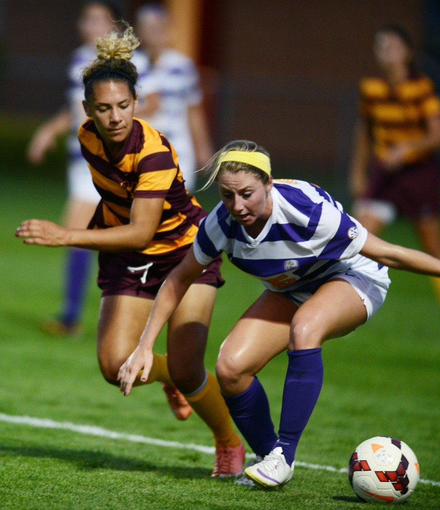 Minnesota defender Taylor Stainbrook tries to get the ball from Louisiana State on Friday, Sept. 6, 2013, at Elizabeth Lyle Robbie stadium.