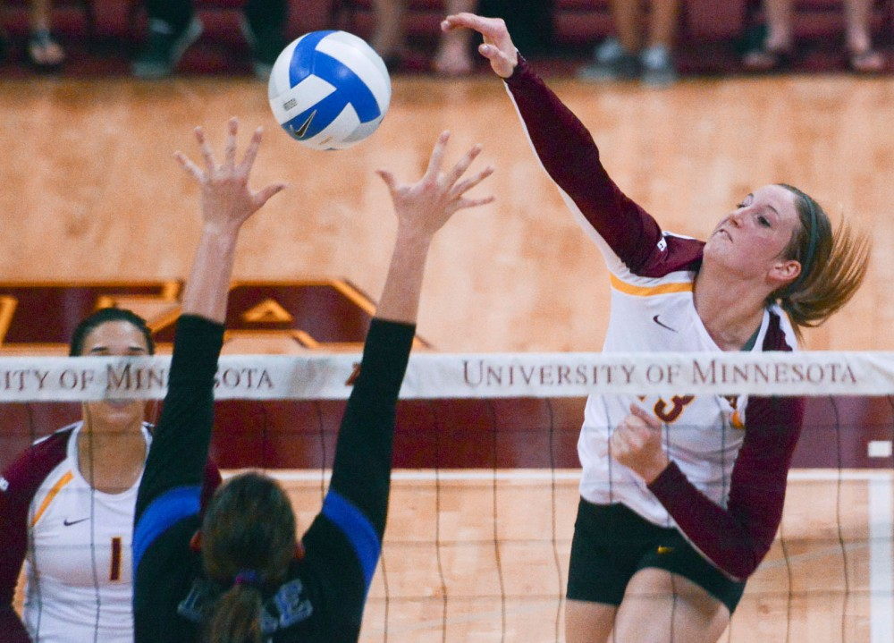 Minnesota senior outside hitter Ashley Wittman spikes the ball against Duke on Saturday, Sept. 7, 2013, at the Sports Pavilion.