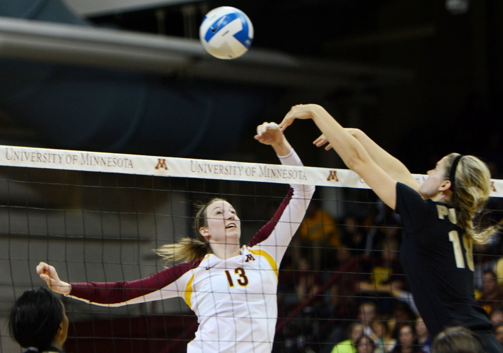 Gopher's Ashley Wittman makes a kill against Purdue on Sunday at the Sports Pavilion.