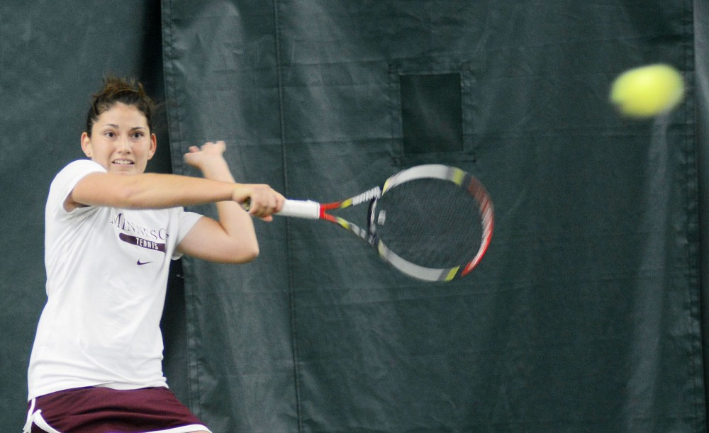 Minnesota junior Tereza Brichacova hits a forehand against Iowa State on Sunday at Baseline Tennis Center.
