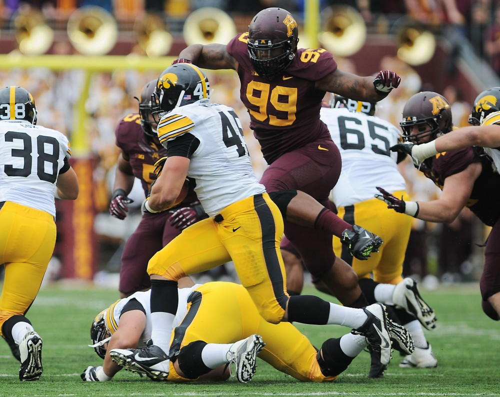 Minnesota defensive lineman Ra'shede Hageman moves to tackle a Hawkeye on Saturday afternoon at TCF Bank Stadium.