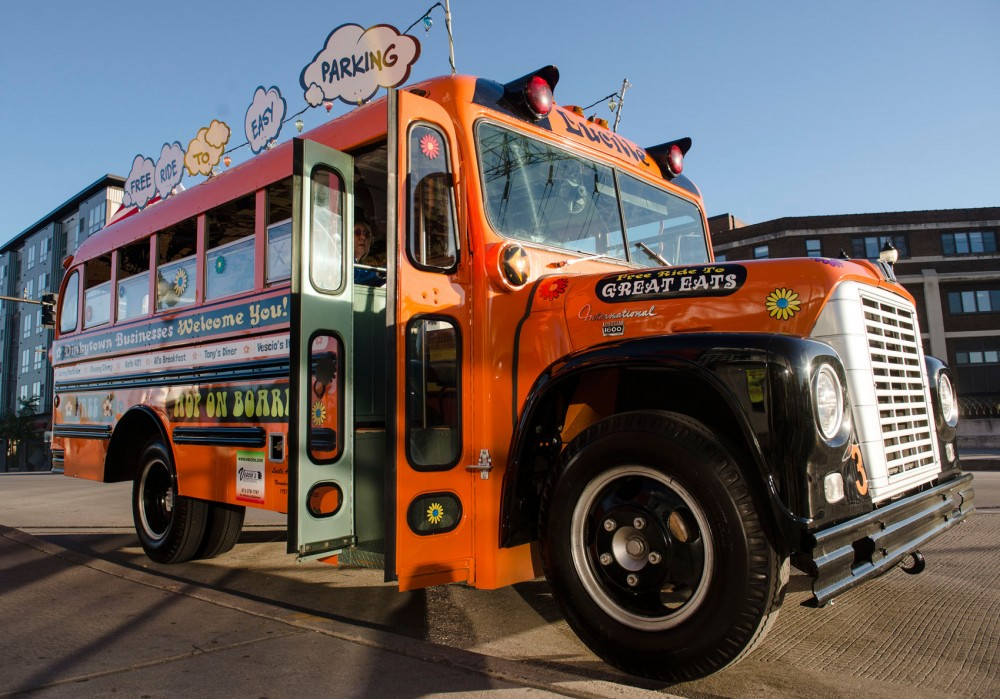 """The no-cost bus, named """"Lucille,""""  will shuttle people from the University of Minnesota's 4th Street Ramp to a stop outside Gold Country Apparel on Southeast Fourth Street.  The bus will run six nights a week, between 5 and 9 p.m."""