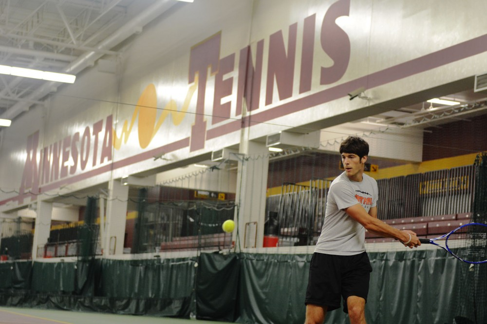 Junior chemical engineering major Joe Amato practices at the Baseline Tennis Center on Monday, Sept. 9, 2013. The facility generated a total of $595,000 in rental income for the athletics department this year, more than any University athletic facility.