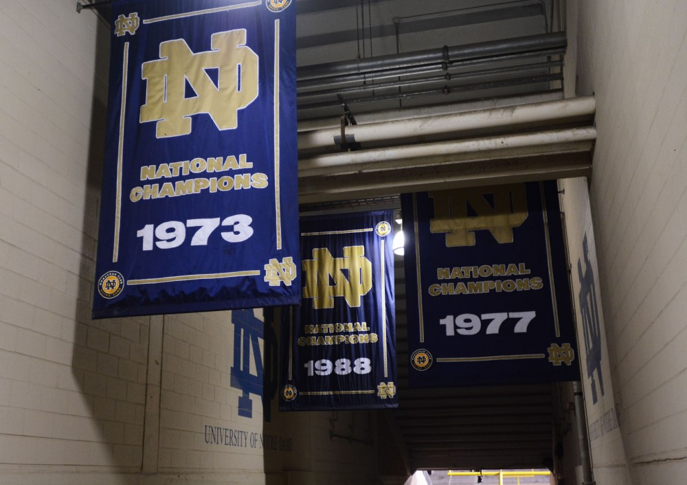 University of Notre Dame's banners celebrate the football championships they've won in the tunnel leading to the Notre Dame stadium in Notre Dame, Ind.