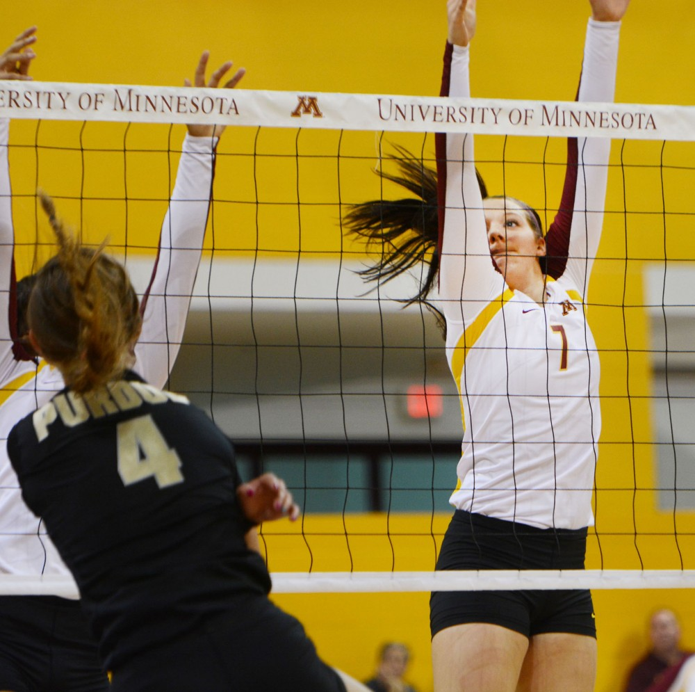 Minnesota middle blocker Hannah Tapp blocks a ball against Purdue on Saturday, Sept. 28, 2013, at the Sports Pavilion.