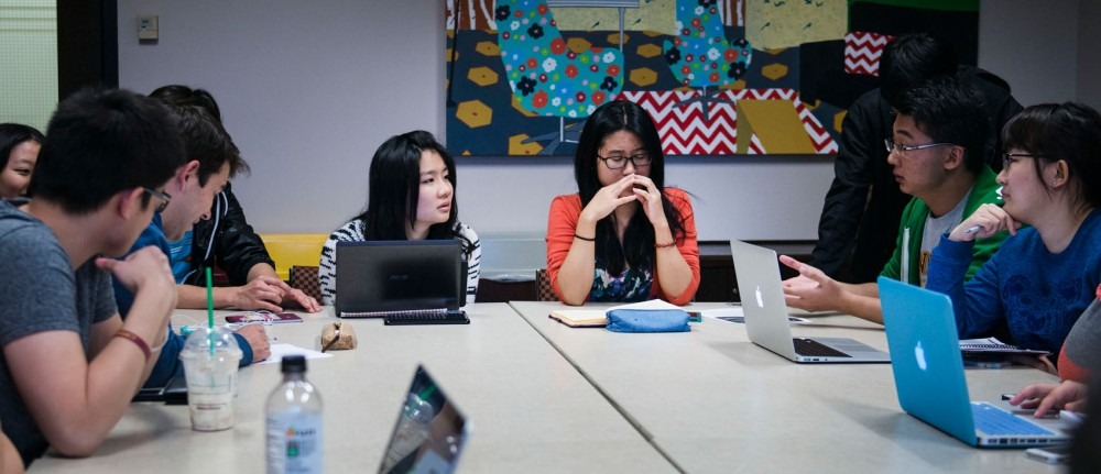 Students share ideas at the Global China Connection meeting in STSS on Friday. Global China Connection was created to help promote mutual appreciation and understanding between China and the Western World.