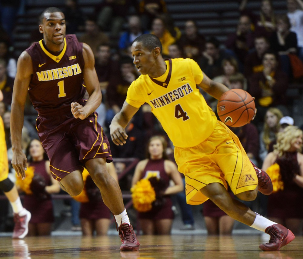 Junior Deandre Mathieu dribbles up the court at Williams Arena on Friday, Oct. 18, 2013.
