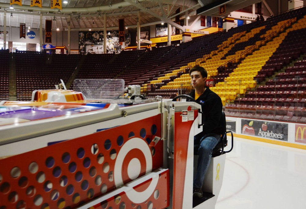 Senior economics major Scott Judd drives a zamboni to clean up the ice after a free skate time at Mariucci Arena on Monday. Judd has been a zamboni driver for two years after going through a two-month training.