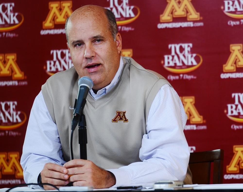 Minnesota athletics director Norwood Teague announces that head football coach Jerry Kill will take a leave to continue focusing on his epilepsy treatment on Thursday, Oct. 10, 2013 at TCF Bank Stadium. Tracy Claeys will serve as the acting head coach in Kill's absence.