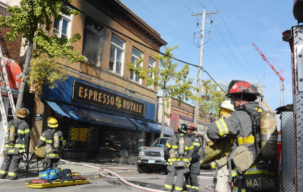 Firefighters work on an apartment that caught fire above Espresso Royale in Dinkytown on Friday afternoon.