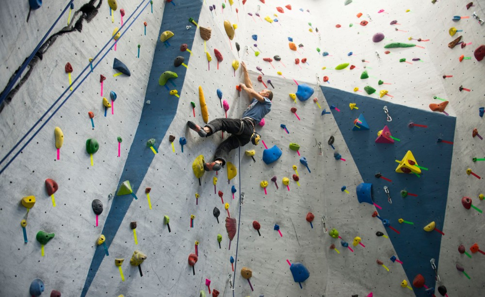 Vice president of the Minnesota Climbing Team Joe Zelman climbs on Tuesday at the rock wall in the Recreation Center.