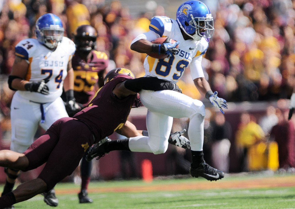 Minnesota safety Cedric Thompson tackles San Jose State wide receiver Chandler Jones on Saturday, Sept. 21, 2013, at TCF Bank Stadium.