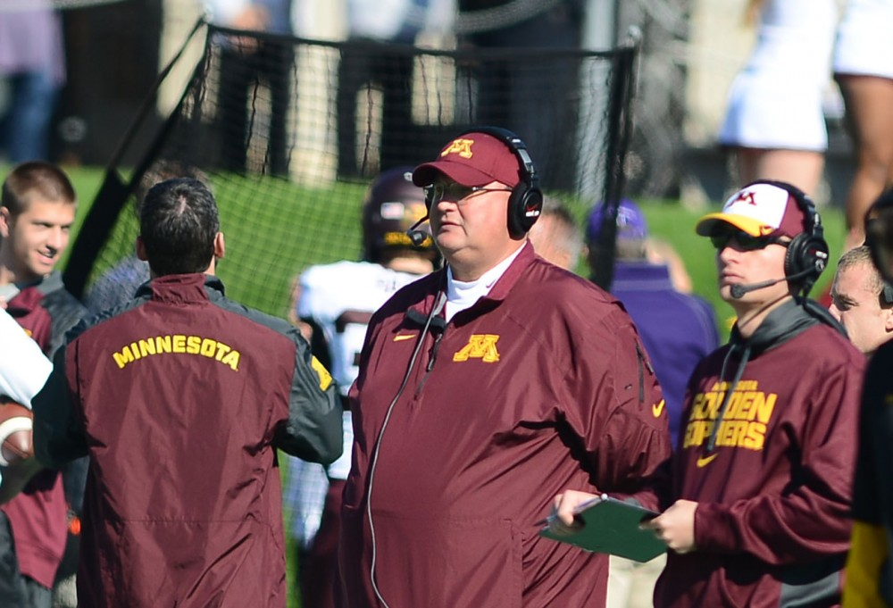 Gophers acting head coach and defensive coordinator Tracy Claeys coaches from the sidelines at Saturday's game against Northwestern at Ryan Field in Evanston, Ill.