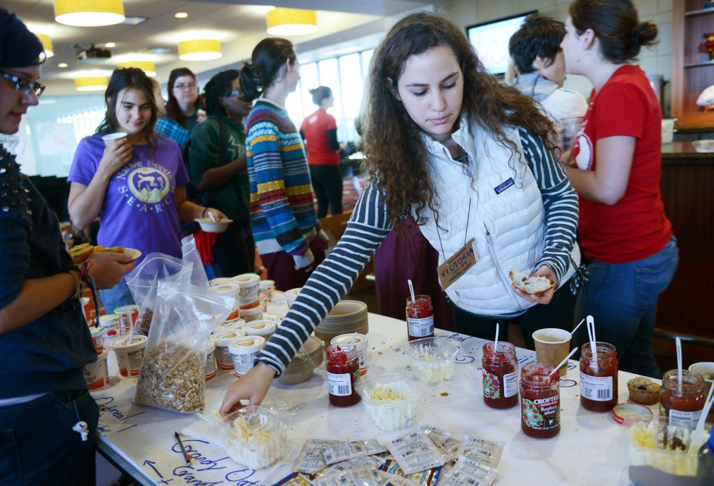 Students put together breakfasts at Real Food Rising, a national summit of student leaders, on Saturday at TCF Bank Stadium. At the summit, they engaged in strategizing, training, and discussion about the current food movement.