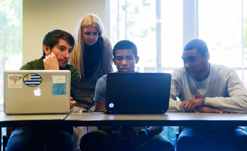 University students Austin Kedrowski, Kassi Vickerman, Matthew Ogbeifun and Tarek Abdelkhalig review video footage from a G-Eazy concert at the Roy Wilkins conference room on Wednesday.