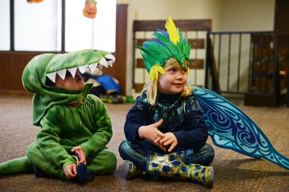 3-year-old Samuel Luhmann, dressed as an alligator, and 5-year-old Johanna Anderson, dressed as Toothiana, sit down with the Minnesota Daily to talk about Halloween at the Como Student Community Cooperative on Friday. CSCC provides housing for graduate students and their families.