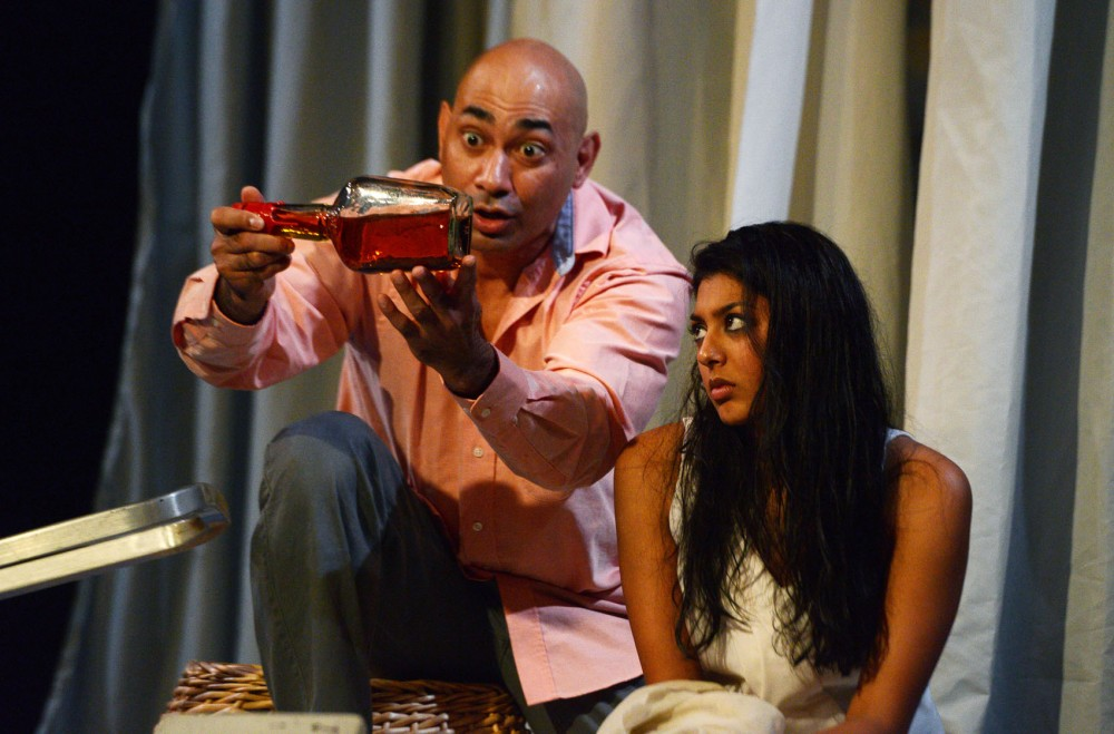 Lipica Shah, right, playing Shiv, and Andrew Guilarte, left, playing her father, rehearse at the Mixed Blood Theatre on Tuesday afternoon.