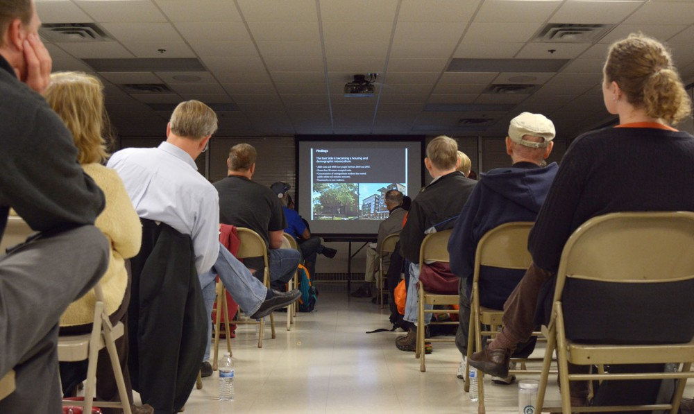 Audience members listen to urban designer Andrew Dresdner explain the master plan for Marcy-Holmes Neighborhood at the Union Labor Center on Tuesday.
