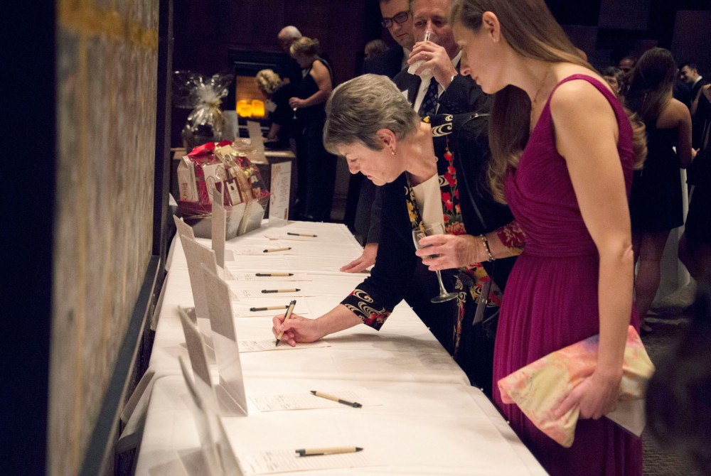 Sue Payne bids on the silent auction at the 50th Anniversary Transplant Gala celebrating 50 years of transplantation on Friday evening at McNamara Alumni Center.