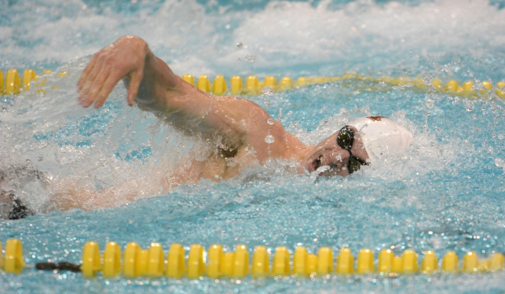Minnesota senior Derek Toomey swims in the men's 100-yard freestyle on Saturday at the University Aquatic Center.