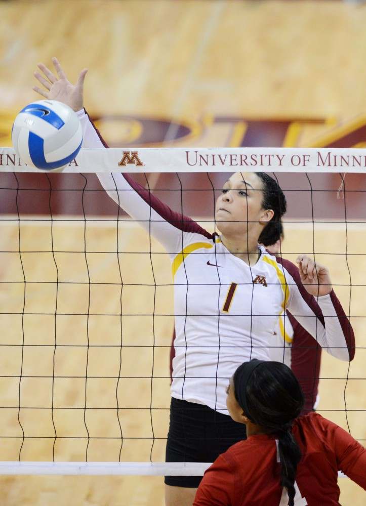 Minnesota outside hitter Daly Santana blocks the ball on Wednesday, Sept. 25, 2013, against Indiana at the Sports Pavilion.