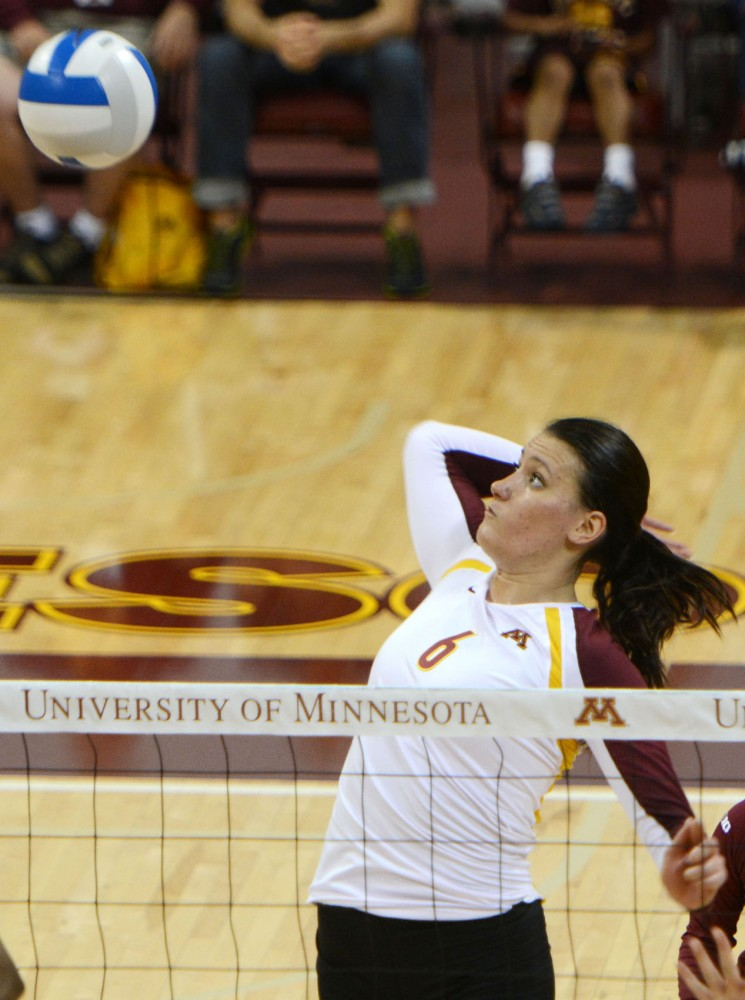 Minnesota Tori Dixon prepares to spike the ball against Purdue on Saturday, Sept. 28, 2013, at the Sports Pavilion.