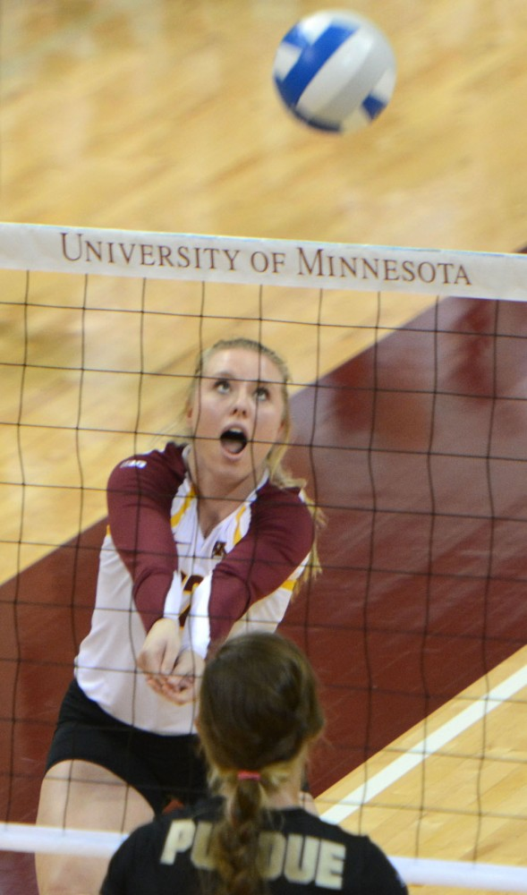 Gopher's Morgan Bohl bumps the ball back to Purdue on Saturday, Sept. 28, 2013, at the Sports Pavilion.