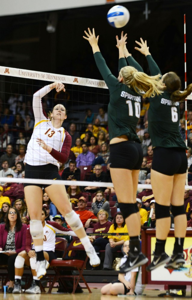 Minnesota outside hitter Ashley Wittman spikes the ball over the net against Michigan State on Thursday, Oct. 17, 2013, at the Sports Pavilion.