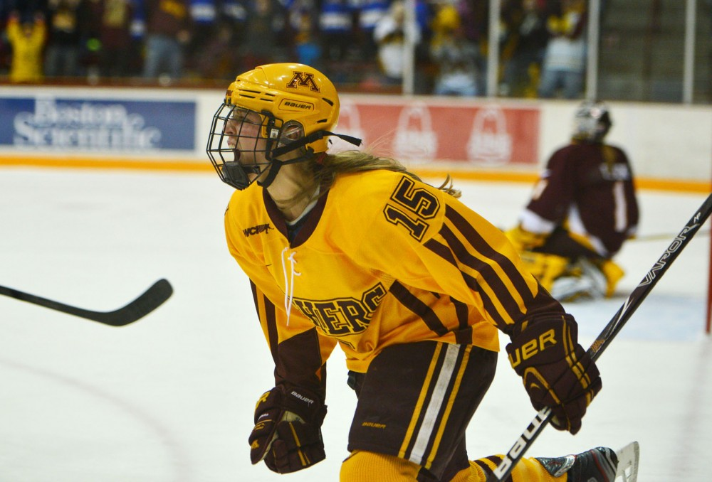 Minnesota forward Rachael Bona yells out to her teammates after scoring a point against Minnesota Duluth on Saturday, Feb. 2, 2013, at Ridder Arena.