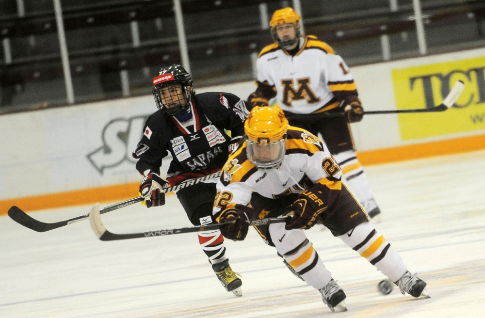 Sophomore forward Hannah Brandt skates with the puck during the Gophers' exhibition game against Team Japan on Thursday, Sept. 26, 2013, at Ridder Arena.