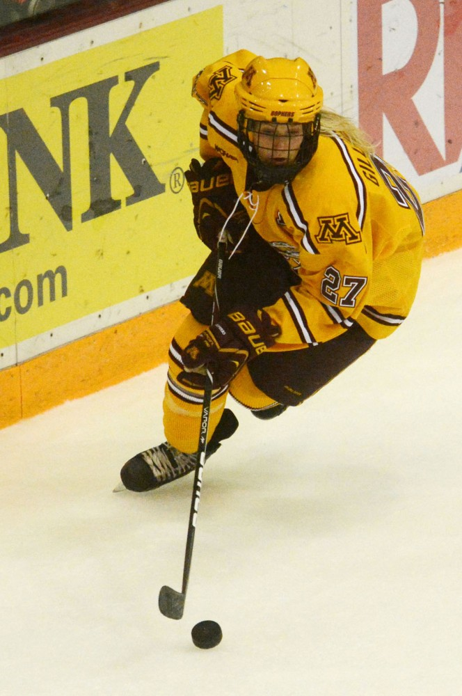 Minnesota senior Baylee Gillanders moves the puck on Saturday at Ridder Arena.