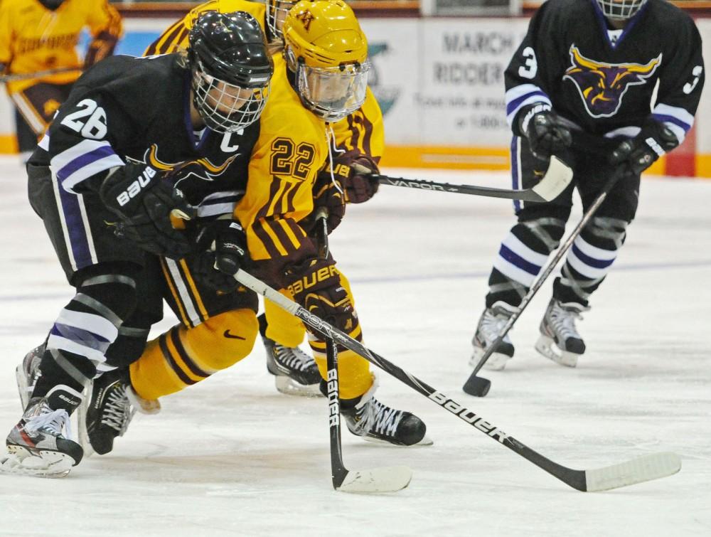 Minnesota forward Hannah Brandt battles Minnesota State-Mankato forward Kari Lundberg on Nov. 17, 2012, at Ridder Arena.
