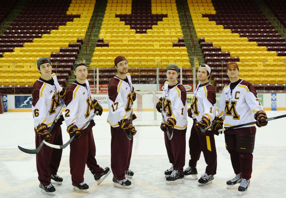 Minnesota's Christian Isackson, Travis Boyd, Seth Ambroz, Sam Warning, Ben Marshall and Kyle Rau on Saturday at Mariucci Arena. All six players are juniors on the Gophers men's hockey team and live in a house together.