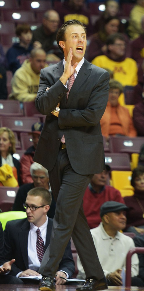 University of Minnesota head men's basketball coach Richard Pitino coaches from the sidelines during the game against Cardinal Stritch University on Friday, Nov. 1, 2013.