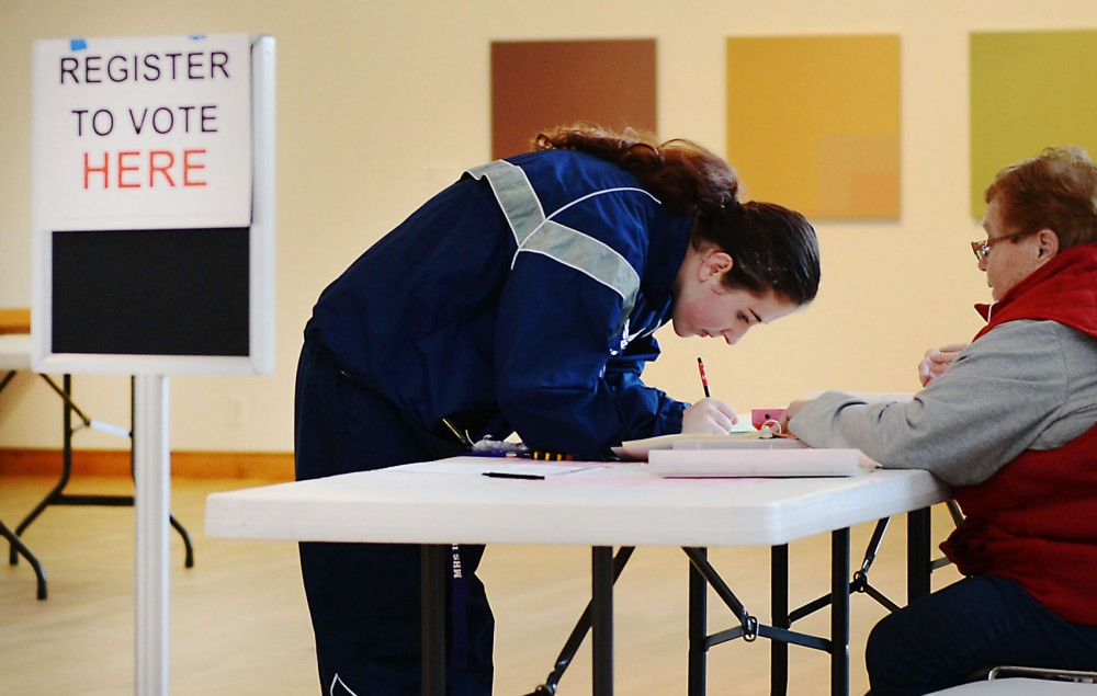 A student registers to vote Tuesday at the Weisman Art Museum.