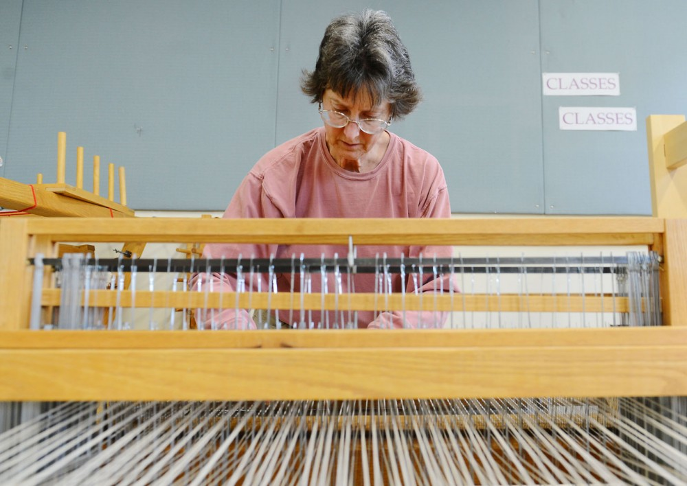 Karen Larson weaves Monday afternoon at the Weavers Guild of Minnesota.