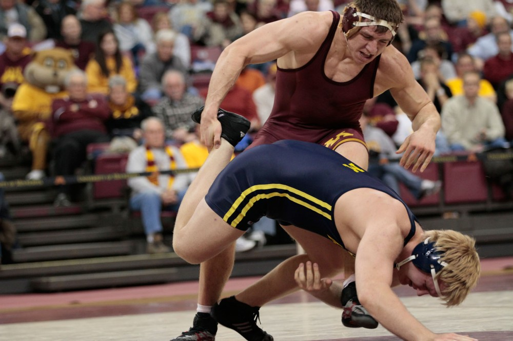 Minnesota's Tony Nelson wrestles against a Michigan opponent Friday, Jan. 27, 2012, at the Sports Pavilion.