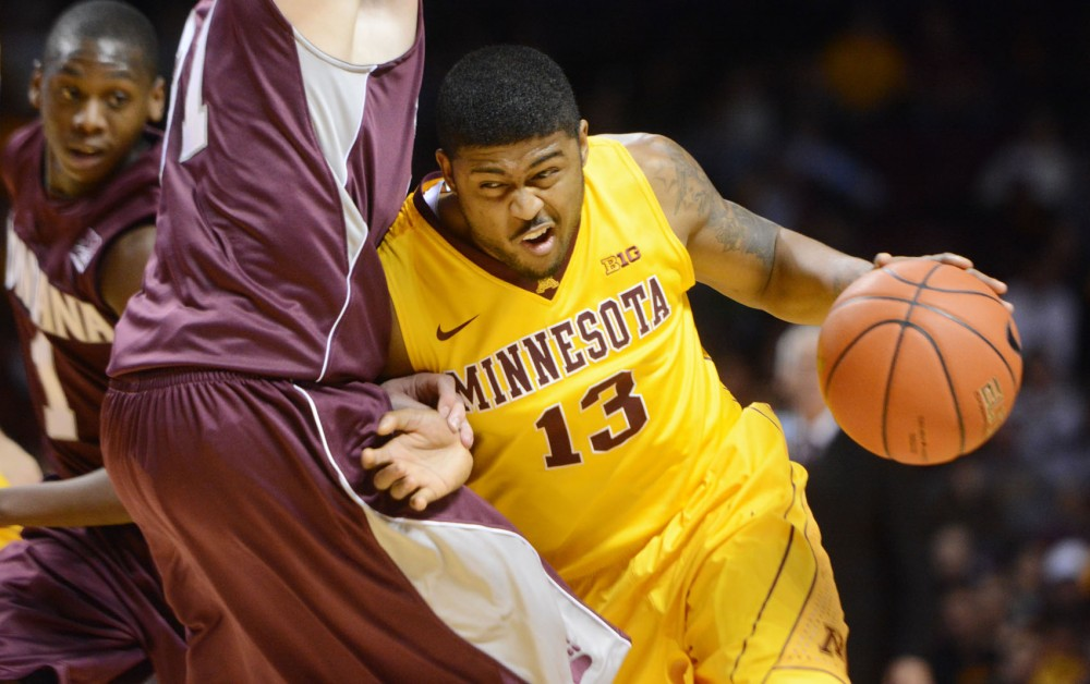 Minnesota guard Maverick Ahanmisi drives the ball against Montana on Tuesday at Williams Arena.
