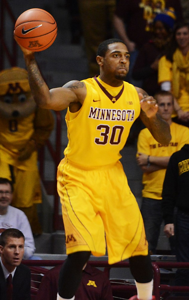 Minnesota guard Malik Smith looks for a pass in the game against Montana on Tuesday, Nov. 12, 2013, at Williams Arena.