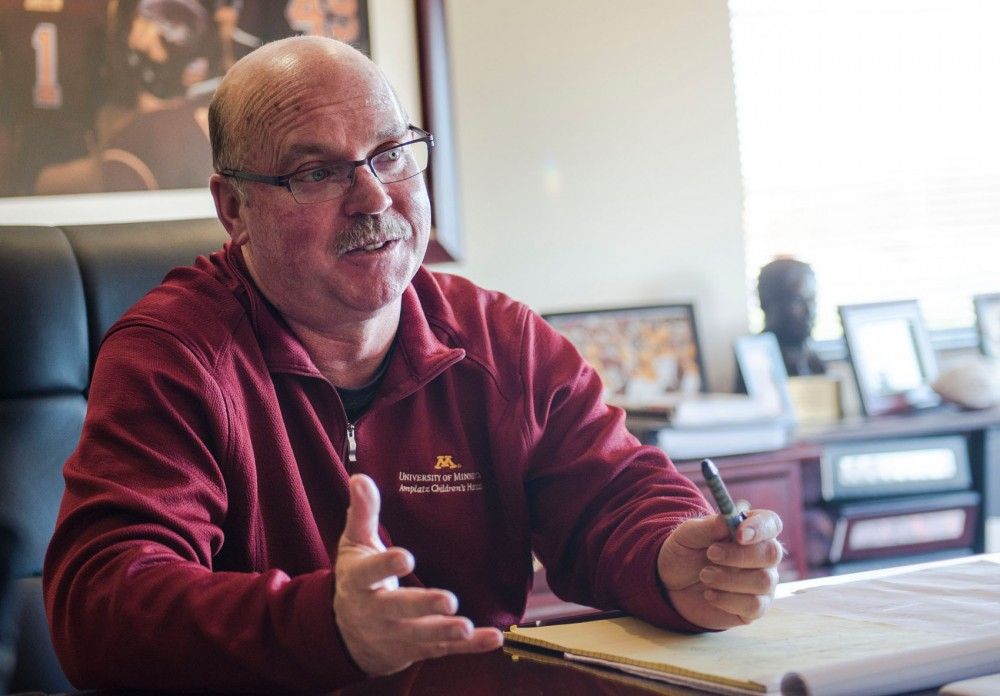 University of Minnesota head football coach Jerry Kill discusses his football career in his office Wednesday, Nov. 13, 2013.