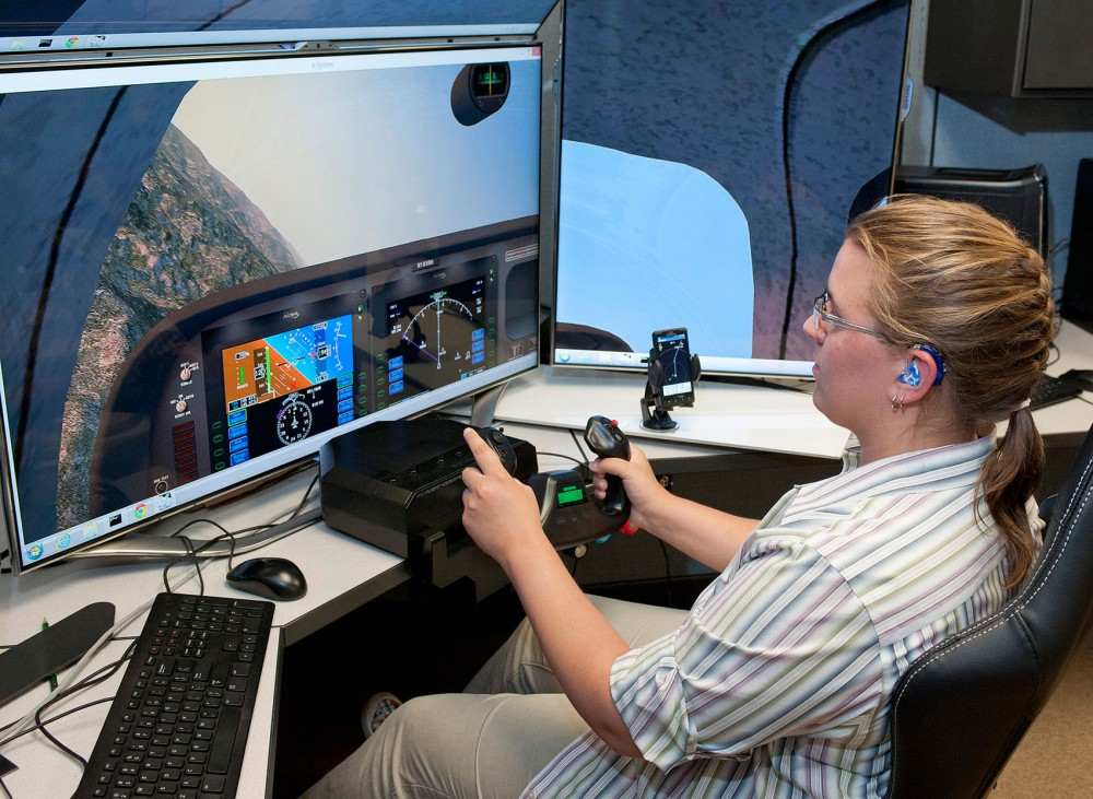 Computer science and engineering student Johanna Lucht pilots a plane simulator to test the collision avoidance on the Android phone app during her internship with NASA this past summer.
