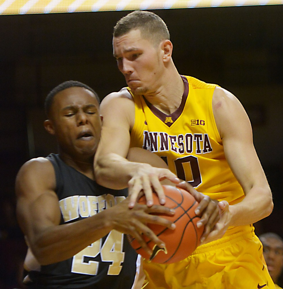 Junior forward Oto Osenieks fights for control of the ball at the game against Wofford on Nov. 21, 2013.