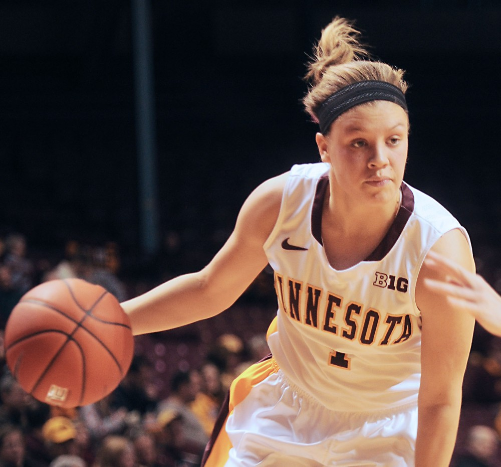 Minnesota Guard Rachel Banham dribbles the ball during the game against Navy on Sunday at Williams Arena.