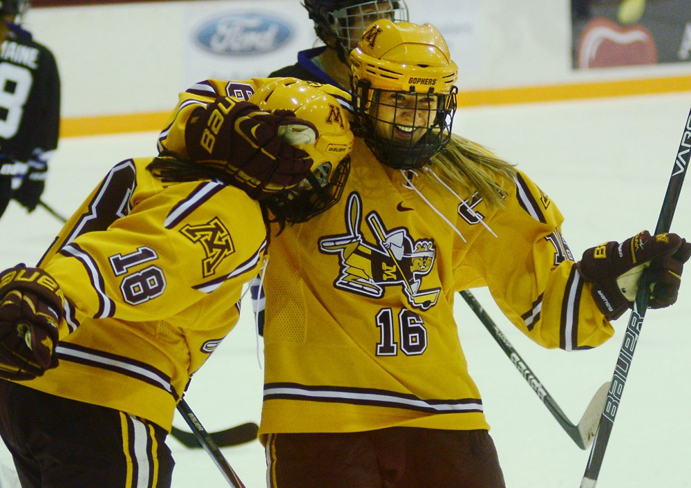 Forwards Brook Garzone and Bethany Brausen celebrate a goal at the Women's Hockey game at Ridder Arena on Friday, Nov. 22, 2013.